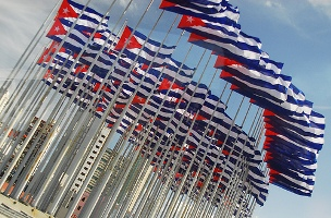 """Flags in front of U.S. Interests in Malecón.  By: Luiza Leite """"Luiza"""" 