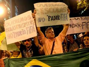 "Antonio Carlos Costa and volunteers from Rio de Paz protesting in the streets of Rio de Janeiro asking the government for ""FIFA Quality"" Hospitals and Schools.  Photo by: Gabriel Telles"