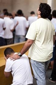 Kneeling in prayer. Photo by: Philip Anema
