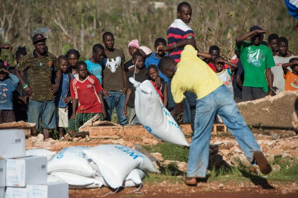 Group of Haitians unpacking supplies