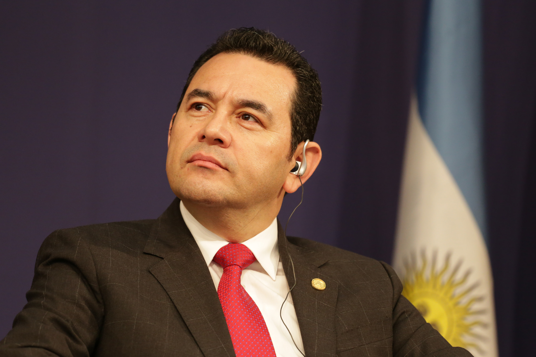 President Jimmy Morales of Guatemala looks upward
