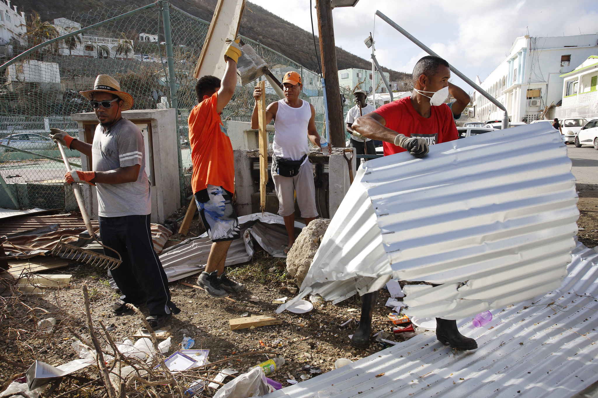 A group of man clear debris