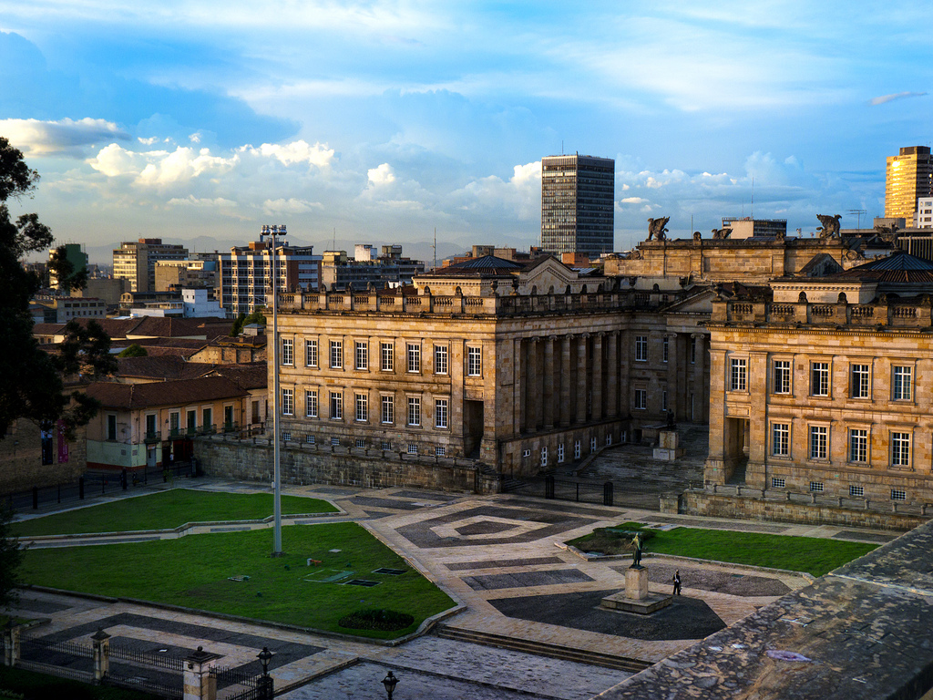 A large open square surrounded by buildings in Colombia
