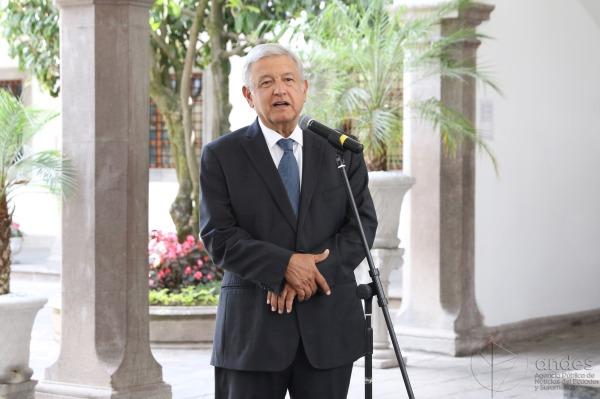 Andrés Manuel López Obrador stands at a microphone