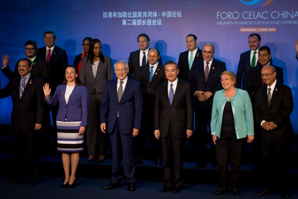 A group of representatives from Latin America and China stand in a group