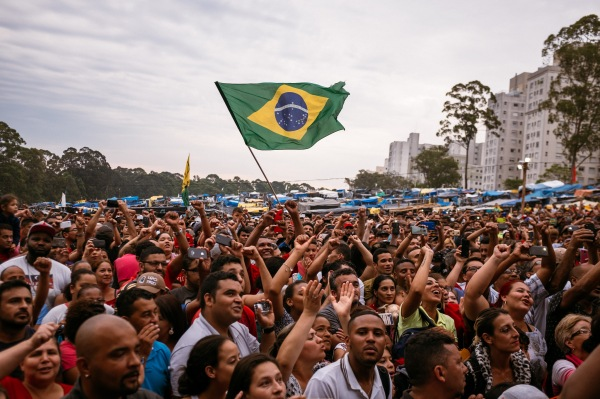 A large group of Brazilians wave the Brazilian flag