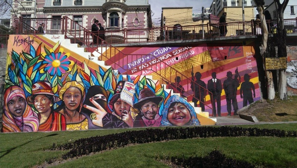 """Image of colorful mural with diverse images of women. Text in the mural says: """"It is time to act, no more sexual violence. No more impunity"""""""