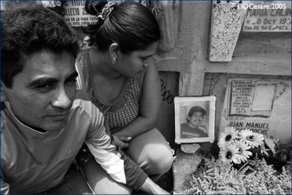 Family members of slain gang member at his gravesite