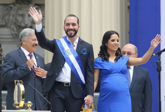 President Nayib Bukele and his wife waving to the crowd on his inauguration day