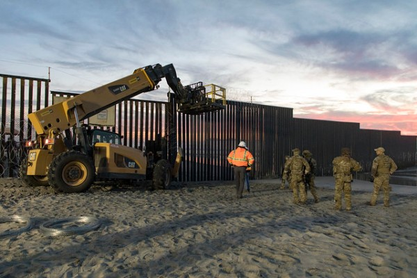 U.S. Border Patrol stands watch during border fence reinforcement / U.S. Customs and Border Protection / https://www.flickr.com/photos/cbpphotos/44997385775/in/photostream/