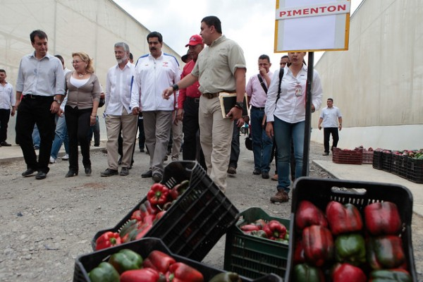 Venezuelan President Nicolas Maduro walking with community leaders