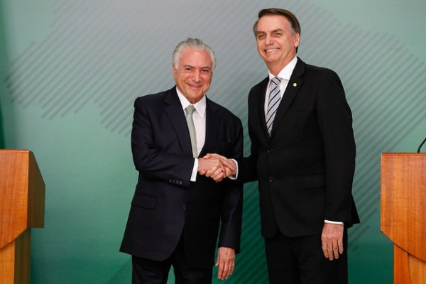 Current Brazilian President Jair Bolsonaro shaking hands with former President Michel Temer