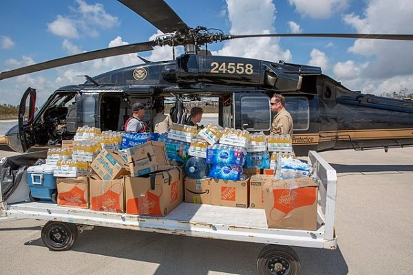 Men loading supplies onto a helicopter