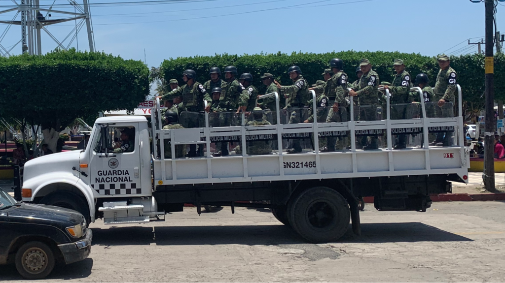 A truckload of military police, wearing National Guard armbands, passes through central Ciudad Hidalgo