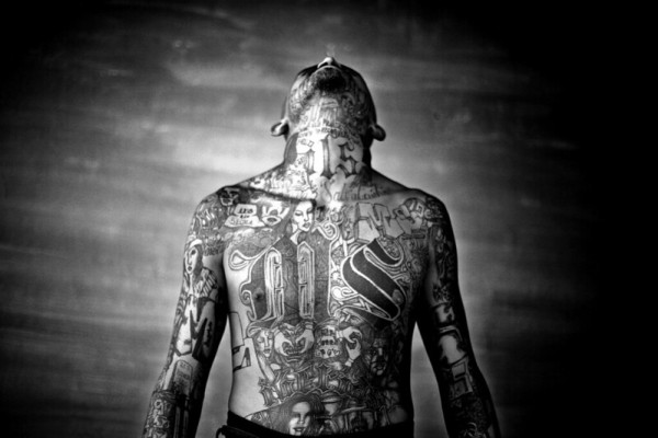 A member of the Mara Salvatrucha gang displays his tattoos inside the Chelatenango prison in El Salvador.